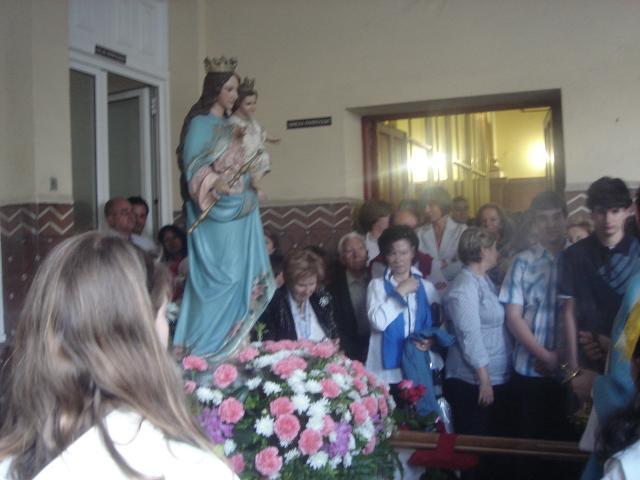 Celebramos la procesión en el pórtico ya que el tiempo no acompañó